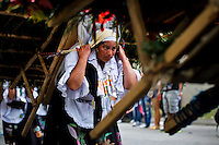 """A silletero woman carries flowers while she attends the traditional """"Silletero"""" parade during the Flower Festival in Medellin August 7, 2012. Photo by Eduardo Munoz Alvarez / VIEW."""