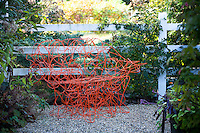 Orange chair, bench garden whimsy