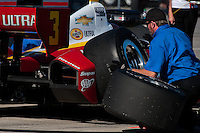 20-21 Febuary, 2012 Birmingham, Alabama USA.Crewman changes the right rear tire for Helio Castroneves.(c)2012 Scott LePage  LAT Photo USA