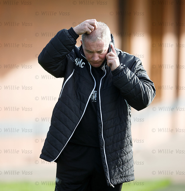 Ally McCoist on the phone at training
