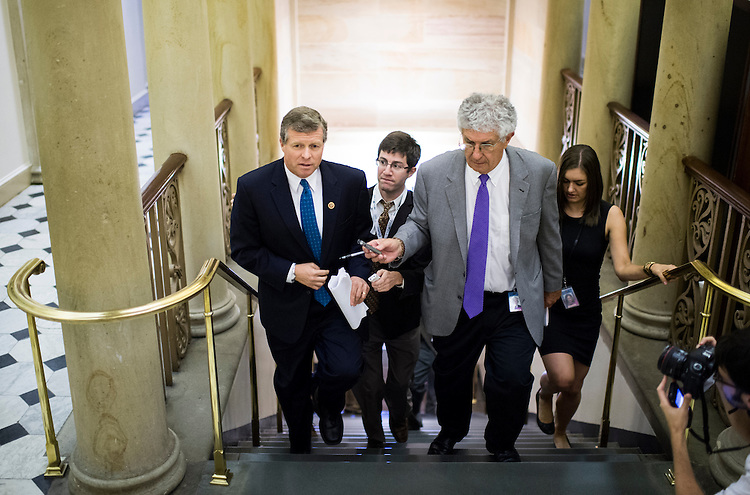 UNITED STATES - SEPTEMBER 30: Rep. Charlie Dent, R-Pa., speaks with reporters about the looming government shutdown as he leaves the House Republican Conference meeting in the basement of the Capitol on Monday, Sept. 30, 2013. (Photo By Bill Clark/CQ Roll Call)
