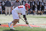 College Park, MD - May 14, 2017: Maryland Terrapins Austin Henningsen (18) scoops the ball during the NCAA first round game between Bryant and Maryland at  Capital One Field at Maryland Stadium in College Park, MD.  (Photo by Elliott Brown/Media Images International)