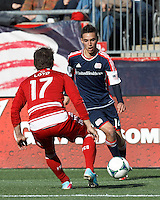 New England Revolution forward Diego Fagundez (14) dribbles. .  In a Major League Soccer (MLS) match, FC Dallas (red) defeated the New England Revolution (blue), 1-0, at Gillette Stadium on March 30, 2013.