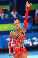 August 23, 2008; Beijing, China; Rhythmic gymnast Evgenia Kanaeva of Russia waves to fans after her clubs routine on way to winning gold in the All-Around final at 2008 Beijing Olympics..