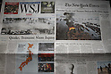 March 13, 2011, Florida, USA - The front pages of some U.S. newspapers, left to right, The Wall Street Journal, The New York Times, reporting Japan's massive earthquake in Doral, Florida, on Sunday, March 13, 2011. The biggest earthquake on record struck the Tohoku region coast on Friday. (Photo by Thomas Anderson/AFLO) [0903] **JAPANESE NEWSPAPER OUT**.