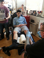 BNPS.co.uk (01202 558833)<br /> Pic: FredCornish/BNPS<br /> <br /> ***Please use full byline***<br /> <br /> Staff at a quiet seaside tattoo studio were shocked when their latest customers walked in - Zayn Malik and his girlfriend Perrie Edwards.<br /> <br /> The One Director singer was visiting the harbour town of Weymouth in Dorset last week and made sure to add to his extensive tattoo collection while he was there.<br /> <br /> He asked for a Native American style design in black and grey ink with white highlights which featured the face of a wolf and two beaded feathers.<br /> <br /> The tattoo was etched onto his left calf and took around two hours to complete at a cost of 150 pounds.<br /> <br /> The 20-year-old pop icon was wearing long grey shorts with a button-down denim shirt and Dr Martens shoes, which he kicked off for his time in the tattooists chair.