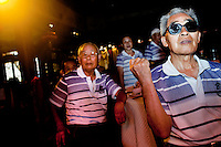 A Chinese tour group, wearing matching polo shirts, enjoy the dancing and singing show at The West Lake Restaurant. Able to seat up to 5,000 people at one sitting, The West Lake Restaurant is the biggest Chinese restaurant in the world. Each week its diners, who staff are taught are 'the bringers of good fortune', devour 700 chickens, 200 snakes, 1,200 kgs of pork and 1,000 kgs of chillis. Its 300 chefs cook in five kitchens and its staff total more than 1,000.It is fully booked most nights.