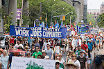 On July 5th more than 10,000 people gathered in Toronto, the traditional territories of the Missisauga peoples, for the March for Jobs, Justice and the Climate. The march told the story of a new economy that works for people and the planet. People marched for an economy that starts with justice, creates good work, clean jobs and healthy communities. The people recognize that we have solutions and we know who is responsible for causing the climate crisis. (Photo: Robert van Waarden