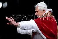 Pope Benedict XVI holds the wooden cross during the Via Crucis (Way of the Cross) torchlight procession on Good Friday in front of the Colosseum in Rome, Friday, April 10, 2009. The evening Via Crucis procession at the ancient Colosseum amphitheater is a Rome tradition that draws a large crowd of faithful, including many of the pilgrims who flock to the Italian capital for Holy Week ceremonies before Easter Sunday