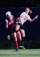 WINSTON-SALEM, NORTH CAROLINA - August 30, 2013:<br />  Katie Walz (27) of Louisville University clashes with Sarah Phillips (25) of Virginia Tech during a match at the Wake Forest Invitational tournament at Wake Forest University on August 30. The game ended in a 1-1 tie.