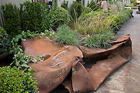 """""""Renewal"""" by Gary Ratway and Mike Lucas at The Late Show Gardens recycled, crushed gas cans"""