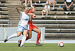 24 September 2006: UNC's Elizabeth Guess (30) and Miami's Corynn Carino (behind). The University of North Carolina Tarheels defeated the University of Miami Hurricanes 6-1 at Fetzer Field in Chapel Hill, North Carolina in an NCAA Division I women's soccer game.