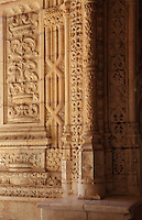 Intricately carved pillars and walls in the arcade of the Cloister, built in Manueline style by Diogo Boitac, Joao de Castilho and Diogo de Torralva, completed 1541, in the Jeronimos Monastery or Hieronymites Monastery, a monastery of the Order of St Jerome, built in the 16th century in Late Gothic Manueline style, Belem, Lisbon, Portugal. The cloister wings have wide arcades with rectangular column and tracery within the arches. The monastery is listed as a UNESCO World Heritage Site. Picture by Manuel Cohen
