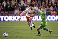 Mehdi Ballouchy (10) of the New York Red Bulls is defended by Osvaldo Alonso (6) of the Seattle Sounders. The New York Red Bulls defeated the Seattle Sounders 1-0 during a Major League Soccer (MLS) match at Red Bull Arena in Harrison, NJ, on March 19, 2011.