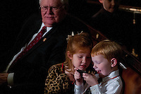 Rep. Joe Pitts' (R-PA) grandchildren Hannah Offutt, 7, and Joseph Offutt, 5, entertain themselves with an iPhone before the start of the 113th Congress onThursday, Jan. 3rd, 2013 in Washington. (Photo by Jay Westcott/Politico)