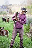 Paul Kaiser with day old lamb, Soay sheep (Ovis aries) at Singing Frogs Farm