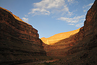 Sunrise, light on the high canyon walls, San Juan River, Utah