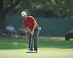 Golfer Richard Johnson putts on the 2nd hole at the PGA FedEx St. Jude Classic at TPC Southwind in Memphis, Tenn. on Thursday, June 9, 2011.