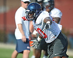 Ole Miss' C.J. Johnson (10) goes through a drill at  football practice in Oxford, Miss. on Sunday, August 7, 2011.