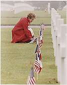 First Lady Nancy Reagan lays flowers at the Omaha Beach Memorial Cemetery, Normandy, France on June 11, 1982.<br /> Credit: White House via CNP