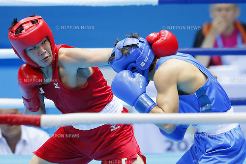 (L-R) Toshihiro Suzuki (JPN), Tumenov Blbert (RUS), <br /> AUGUST 24, 2014 - Boxing : <br /> Men's Light Welter Weight semi final<br /> at Nanjing International Expo Centre Hall D  <br /> during the 2014 Summer Youth Olympic Games in Nanjing, China. <br /> (Photo by Yusuke Nakanishi/AFLO SPORT)