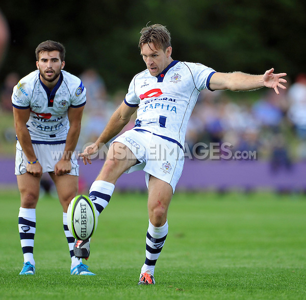 Adrian Jarvis kicks for territory. Pre-season friendly match, between Bristol Rugby and Newport Gwent Dragons on August 17, 2014 at the Cribbs Causeway Ground in Bristol, England. Photo by: Patrick Khachfe / JMP