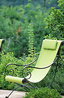 A wrought iron deck chair with a shape inspired by the Provençal style