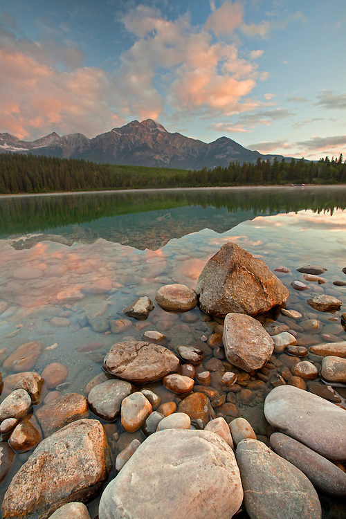 Pyramid Mountain reflects into Patricia Lake at sunrise in Jasper National Park, Alberta, Canada