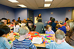 Garden City, New York, U.S. January 20, 2014. STACEY LEE, Outreach Director of Long Island Children's Museum, presents the program 'Dreaming with Dr. Martin Luther King, Jr.', where children explore Dr. King's life and then create collages of peace, for the American official federal holiday Birthday of Martin Luther King, Jr.