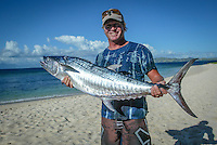 The 203 Quiksilver Pro Fiji was won by current World Surfing Champion, Hawaiian Andy Irons (HAW) with his good friend and travelling partner Florida surfer Cory Lopez (USA) finishing runner up. <br /> On lay days during the contest a lot of the tour surfers would go fishing. Michael Lowe (AUS) with the Catch of The Day, a good size Spanish Mackeral. Photo: joliphotos.com