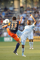 Marco Estrada (13) midfield Montpellier and Julio Cesar (55) midfield Sporting KC stretch for the ball..Sporting Kansas City were defeated 3-0 by Montpellier HSC in an international friendly at LIVESTRONG Sporting Park, Kansas City, KS..