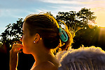 At late dusk, girl wearing angel wings, in marshland Norman J. Levy Park and Preserve in Merrick, Long Island, New York, USA.