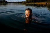 Russian billionaire Sergei Veremeenko enjoys the water in front of his country house in Moscow, Russia.
