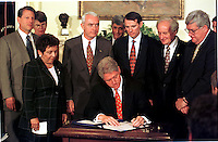 United States President Bill Clinton signs the Drug-Free Communities Act of 1997 at the White House in Washington, D.C. on June 27, 1997. Standing behind the President, left to right, U.S. Vice President Al Gore, U.S. Attorney General Janet Reno, U.S. Secretary of Health and Human Services (HHS) Donna Shalala, General Barry McCaffrey, U.S. Secretary of the Treasury Robert Rubin, U.S. Representative Rob Portman (Republican of Ohio), U.S. Representative Sandy Levin (Democrat of Michigan), and U.S. Representative Dennis Hastert (Republican of Illinois)..Credit: Ron Sachs / CNP. /MediaPunch