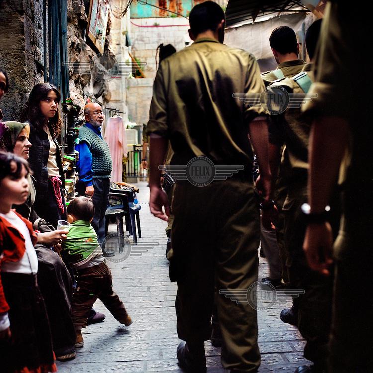 Israeli army patrol the Old City of Jerusalem.