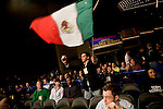 A fan waving the Mexican flag cheers Jose Rivera to victory.. Thursday was the first night of the finals of the  79th annual Golden Glove Boxing tournament. Boxers from all over the New York who made it through the previous rounds were on hand at Madison Square Garden to compete for the coveted Golden Gloves Champion title.