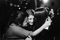 "Switzerland. Canton Ticino. Oggio. Grotthard Café. Micaela Ruef (L), Camille de Righetti (C) and Paola Ranghino (R) celebrate their Matura with joy and emotion. They gently hug together and let themselves be happy. Matura or its translated terms (Mature, Matur, Maturita, Maturità, Maturität, Mатура) is a Latin name for the high-school exit exam or ""maturity diploma"". It is taken by young adults (usually aged from 17 to 20) at the end of their secondary education, and generally must be passed in order to apply to a university or other institutions of higher education. Matura is a matriculation examination and can be compared to A-Level exams or Abitur. A hug is a form of physical intimacy, universal in human communities, in which two people put their arms around the neck, back, or waist of one another and hold each other closely. If more than two persons are involved, this is informally referred to as a group hug. 28.06.15 © 2015 Didier Ruef"