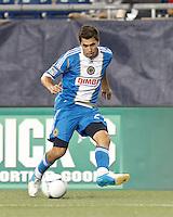 Philadelphia Union midfielder Michael Farfan (21) passes the ball. In a Major League Soccer (MLS) match, the New England Revolution tied Philadelphia Union, 0-0, at Gillette Stadium on September 1, 2012.