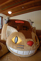 """A """"neko bus"""" soft climbing frame for children. The neko bus is a character from My Neighbor Totoro. The Ghibli Museum in Mitaka, western Tokyo opened in 2001. It was designed by animator Miyazaki Hayao and receives around 650,500 visitors each year."""