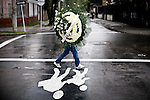 A man carries flowers in a street of Bogota, Colombia. 29/02/2012.  Photo by Eduardo Munoz Alvarez / VIEWpress.