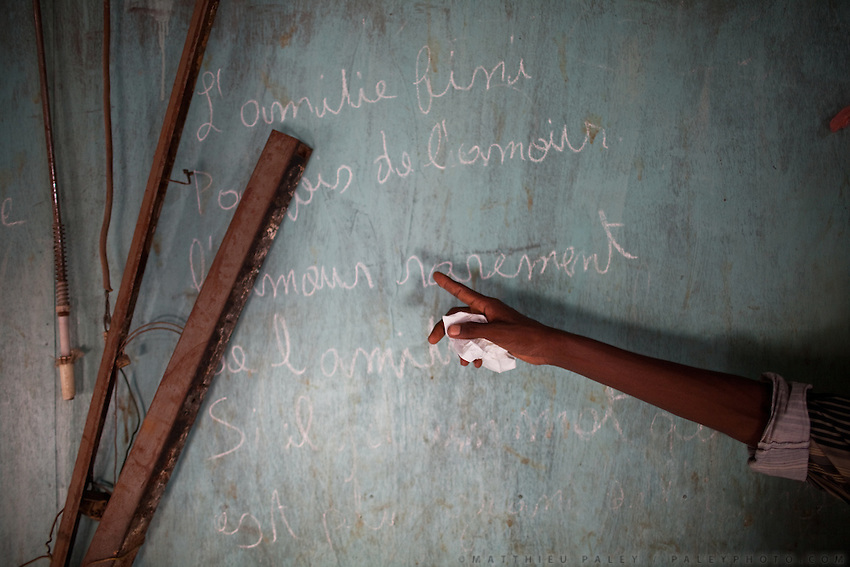 """Friendship is over, maybe some love, but rarely, if there is a word as big as this..."". A poem on the wall of a house in the slums of Arhiba. Poetry on a wall of the Slums. Half the population of Djibouti City live in slums like Arhiba, with little water, work or schools...A walk through Arhiba, a slum mostly inhabited by the Afar tribe, the poorest (and sometimes dangerous) area of Djibouti. Arhiba is faced with huge problems of sanitation, extreme malnutrition (Djibouti is expensive and dependent of all imports), tuberculosis, Aids etc...The geostrategical and geopolitical importance of the Republic of Djibouti, located on the Horn of Africa, by the Red Sea and the Gulf of Aden, and bordered by Eritrea, Ethiopia and Somalia."
