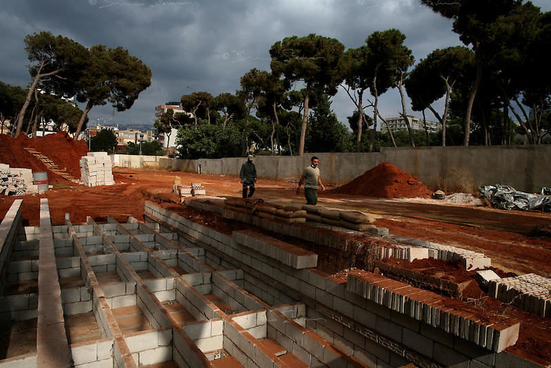 Beirut, Lebanon, Aug 9 2006.Shiyah neighbourhood, Makhbar e Shahideen cemetery, The mass grave ready for the funeral of the 39 civilians, many of them women and children, killed on August 7th, when Israeli bombs levelled an appartment building in this non-Hezbollah suburb of Beirut, without any apparent reason.