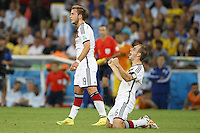 Mario Gotze and Philipp Lahm of Germany celebrate at the final whistle