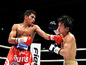 (L-R) Tepparith Kokietgym (THA), Daiki Kameda (JPN), DECEMBER 7, 2011 - Boxing :.Tepparith Kokietgym of Thailand hits Daiki Kameda of Japan during the WBA super flyweight title bout at Osaka Prefectural Gymnasium in Osaka, Osaka, Japan. (Photo by Mikio Nakai/AFLO)