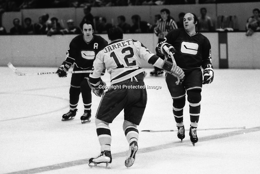 Seals Gary Jarrett after Canucks Jocelyn Guevremont and Ron Ward or Bobby Laionde.<br />