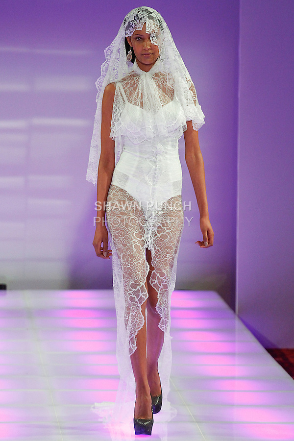 Model walks runway in an outfit from the 3zehn Fall Winter 2014 collection by Kristin Zimmermann, during Couture Fashion Week Fall 2014, on February 14, 2014.