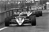 DETROIT, MI - JUNE 22: Teammates René Arnoux of France and Jacques Laffite of France drive their Ligier JS27/Renault EF4B entries during the Detroit Grand Prix FIA Formula One World Championship race on the Detroit Street Circuit in Detroit, Michigan, on June 22, 1986.