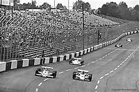 HAMPTON, GA - APRIL 22: Johnny Rutherford (#4 McLaren M24B/Cosworth TC) and Gordon Johncock (Penske PC6/Cosworth TC) race into Turn #1 during the Gould Twin Dixie 125 event on April 22, 1979, at Atlanta International Raceway near Hampton, Georgia.