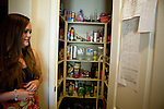 "University of California, Merced student Katilyn McIntire checks the ""chore list"" in the  spacious rental home  she shares in Merced, Calif., October 29, 2011."