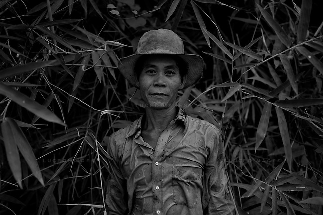 Vietnamese port worker outside of Ho Chi Minh City, Vietnam.